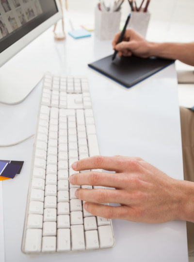 Hands of designer using computer and digitizer in the office